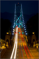 traffic on the lions gate bridge at night from stanley park, vancouver, british columbia, canada