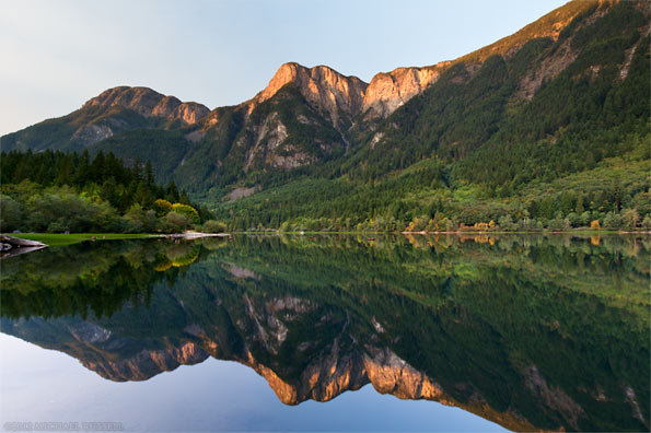 hope mountain and wells peak are reflected in silver lake at silver lake provincial park