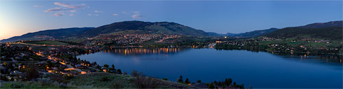 panorama of kalamalka lake, vernon, and coldstream in the evening from vernon british columbia canada