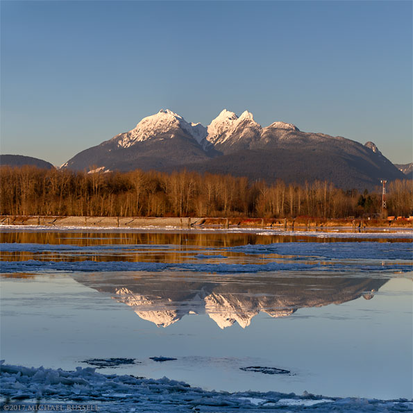 frozen ice fraser river winter golden ears langley british columbia