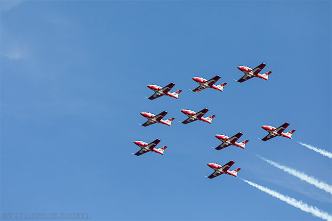 Canadian forces snowbirds in formation over white rock