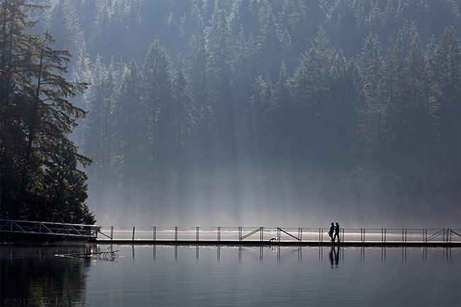 walking over the floating bridge at sasamat lake
