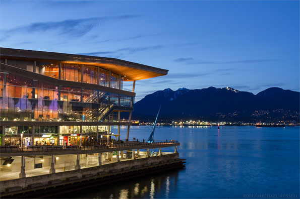 vancouver convention center and the northshore mountains in british columbia canada