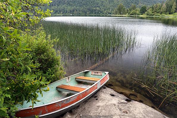 boat on shore of saint mary lake on salt spring island