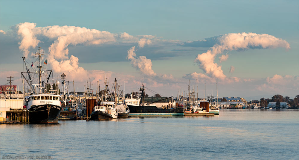 towering cumulus clouds drift across the sky above Steveston harbour