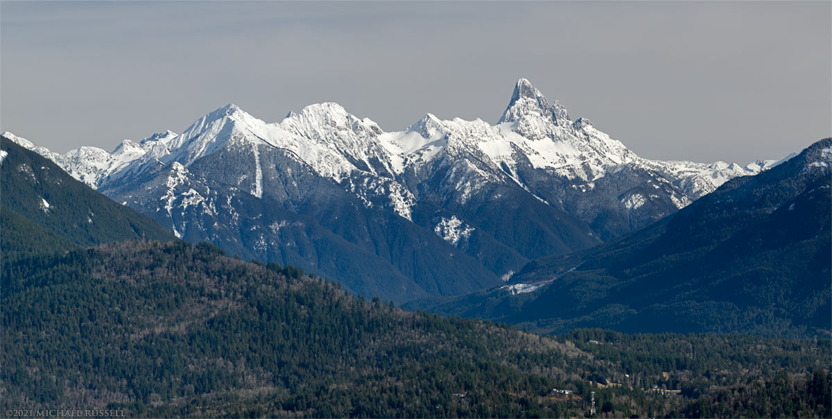 mount slesse, macfarlane, and crossover peak from hillkeep regional park