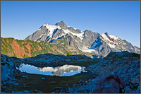mt shuksan reflected in a tarn near artist point