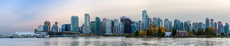 view of downtown vancouver and deadmans island after sunset from stanley park