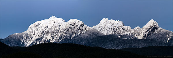 panorama of the golden ears mountains in maple ridge, british columbia, canada