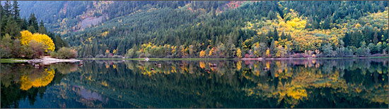 panorama of fall colours reflecting in silver lake in silver lake provincial park