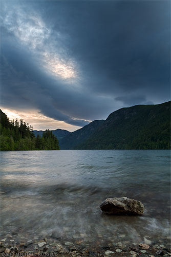 a storm rolls in over cameron lake at sunset - near port alberni bc