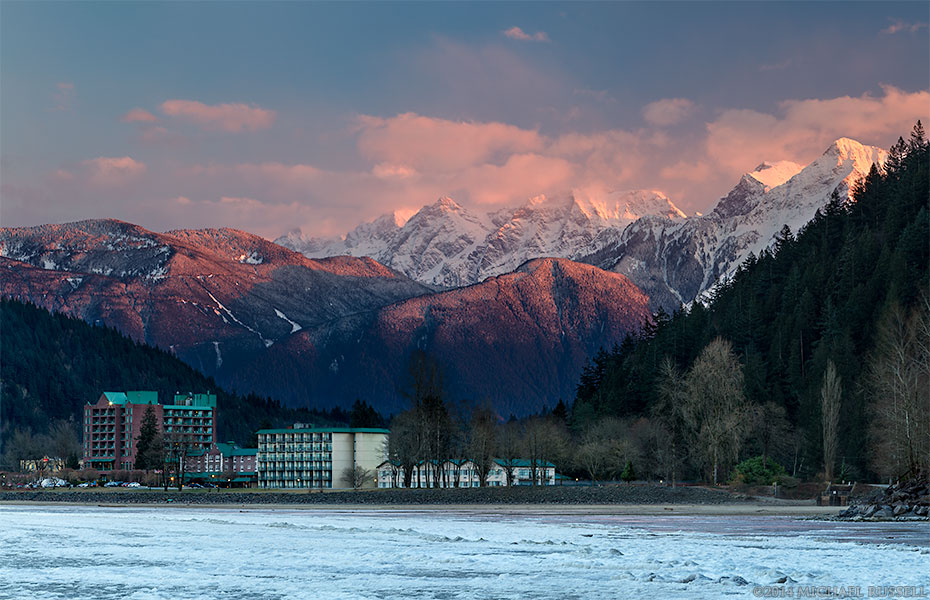 harrison hot springs resort with mount cheam in the background at sunset