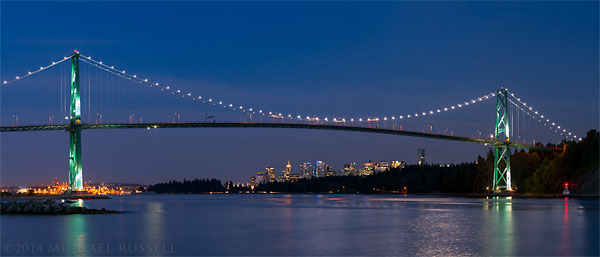 lions gate bridge and downtown vancouver from ambleside beach