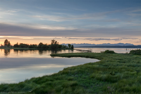 sunset at blackie spit showing boundary bay and the coast range mountains