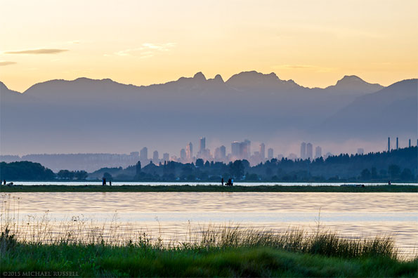 Buildings in Burnaby and the Northshore Mountains from Blackie Spit in Crescent Beach