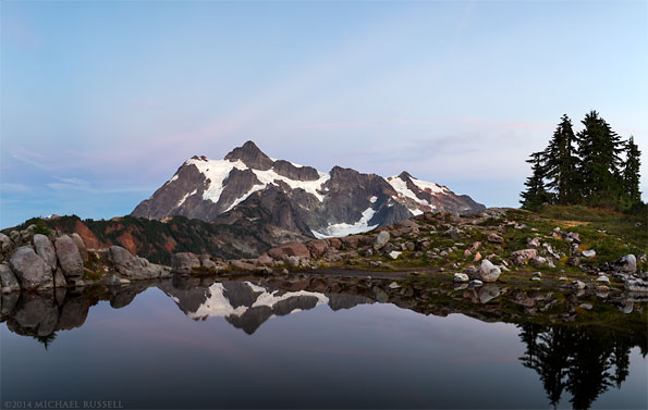 reflection of mount shuksan in a north cascades tarn