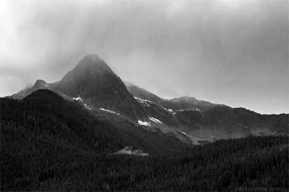 storm clouds rolling over pyramid peak in north cascades national park