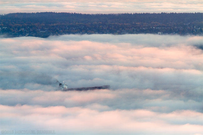 freighter in the fog on english bay vancouver