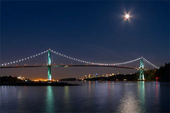 moon over the lions gate bridge in vancouver