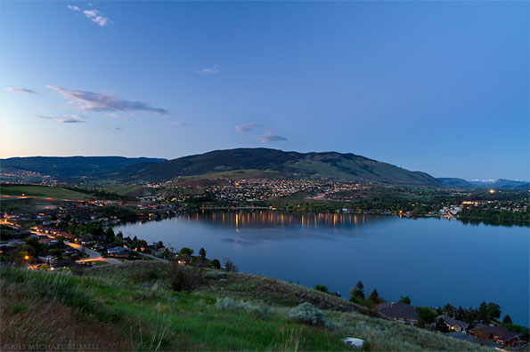 view of vernon coldstream and kalamalka lake at night