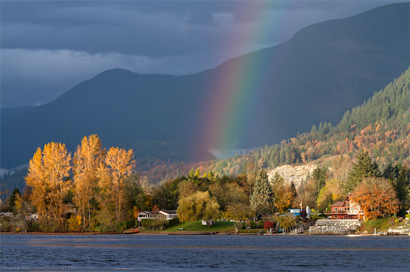 rainbow over hatzic lake in the fraser valley of british columbia