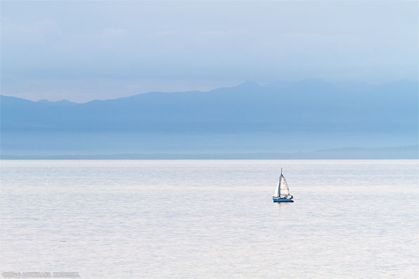 a small hunter 280 sailboat on the salish sea georgia straight west of vancouver bc