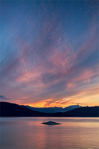 sunset over the grebe islets, bowen island, howe sound and the tetrahedron range from juniper point in lighthouse park