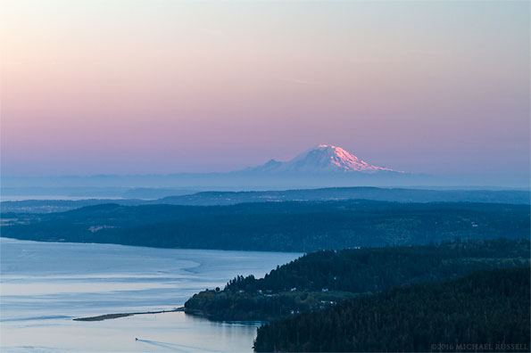 view of a mount rainier sunset from mt. erie in anacortes