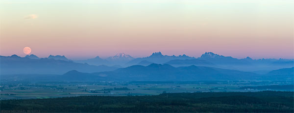 panorama of moonrise over the north cascades range from mt erie park